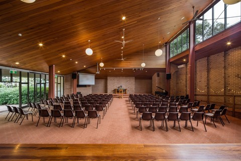 A church building interior with two hundred chairs and audio visuals